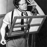 Orson Welles on the microphone